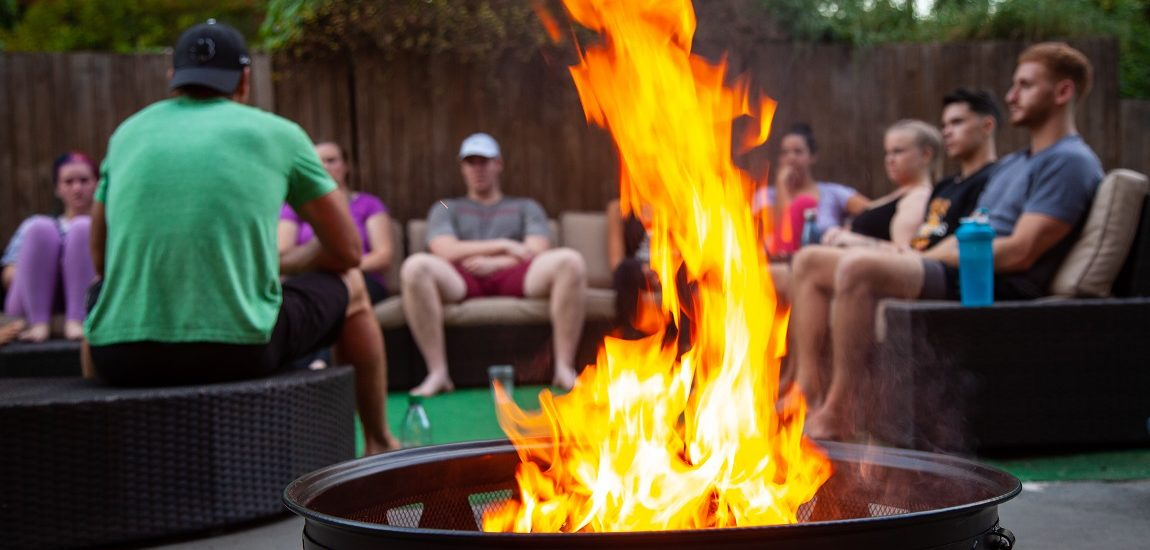 Summer interns learn and bond by the fireside at The Select Group headquarters in Raleigh, NC.