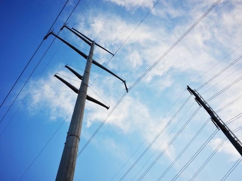 Utilities power lines against blue sky